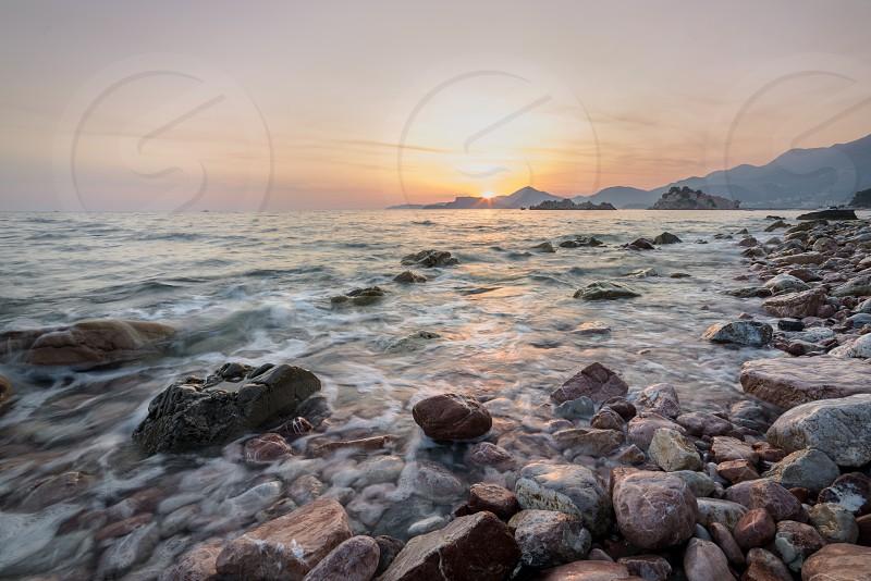Sunset from Montenegro Glavica beach near Svati Stefano photo