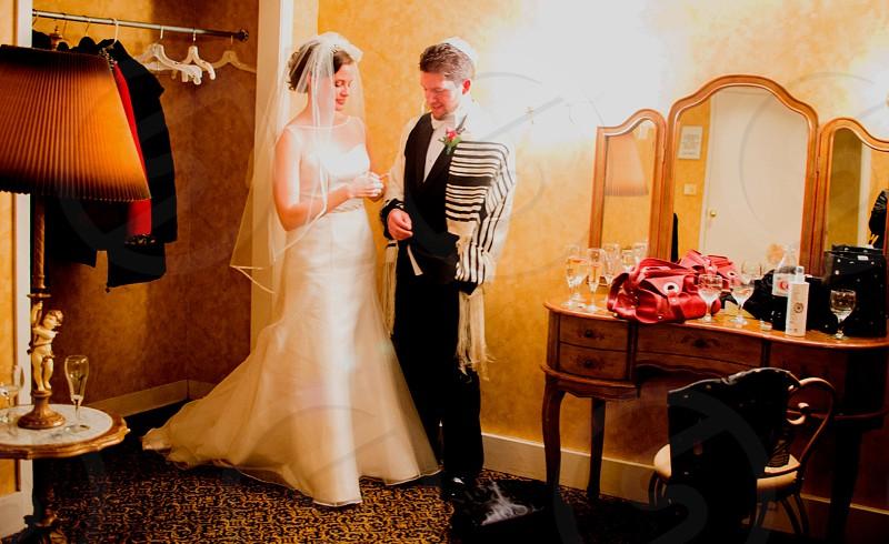 couple standing beside desk vanity mirror photo