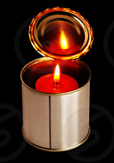 candle on a tin can photo