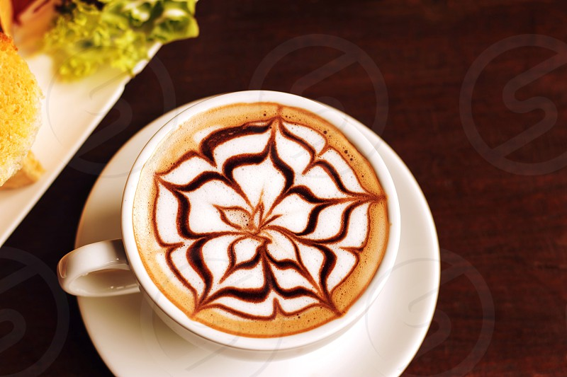Mocha coffee arts in white cup photo