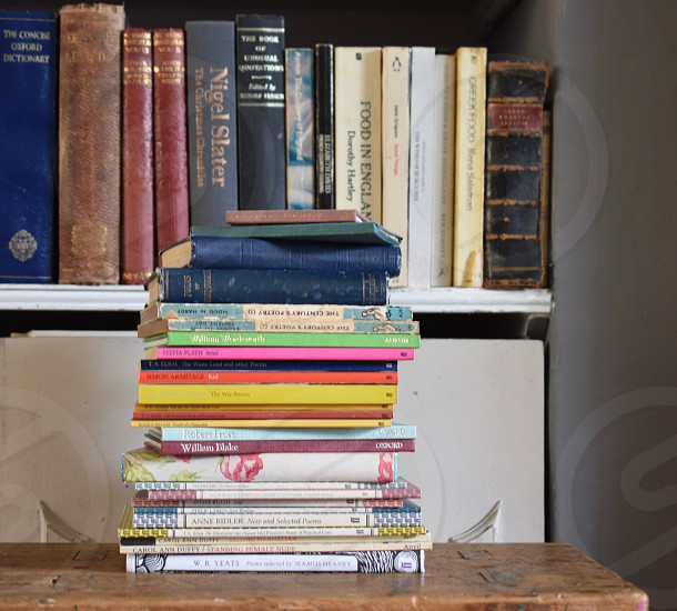 Pile of books in working space. photo