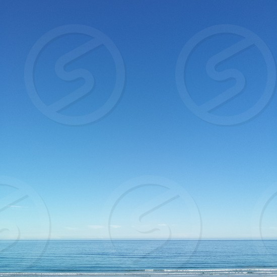 Blue horizon with sea and sky.  calm blues ocean clear simple minimalist photo