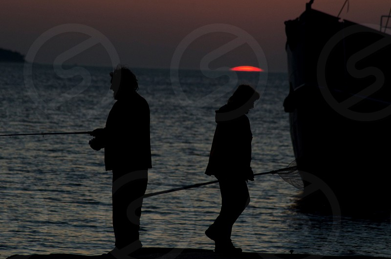 fisherman's silhouette  photo