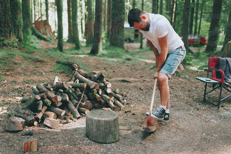 A man chopping wood in the forest. photo