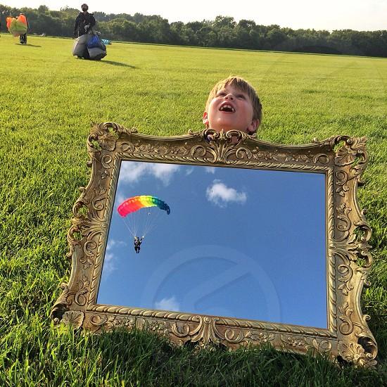 boy holding mirror photo