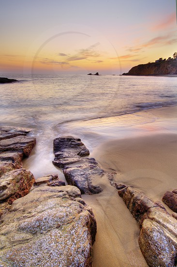 sunset laguna beach california beach rocks ocean sand landscape vertical photo
