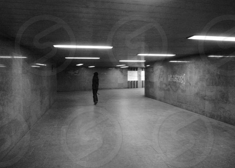 person in underground way photo