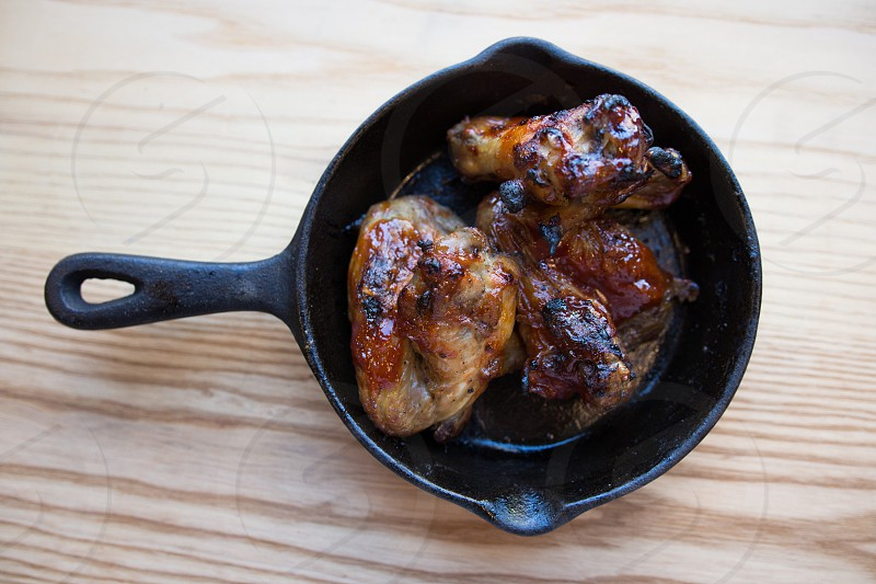 roasted chicken on black ceramic cooking pot photo