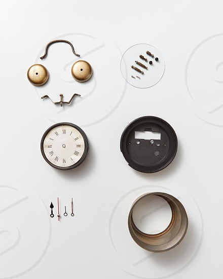 Details of old mechanical watches. Smiling face made of watch details on a gray background with copy space. Flat lay photo