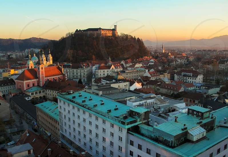 Castle hill in the old town center of Ljubljana Slovenia just before sunset. photo