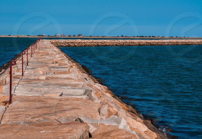 jette rock rocky walkway water ocean  photo