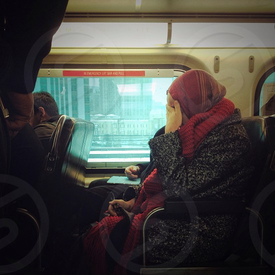 Woman With Head Scarf Sitting On Bus photo