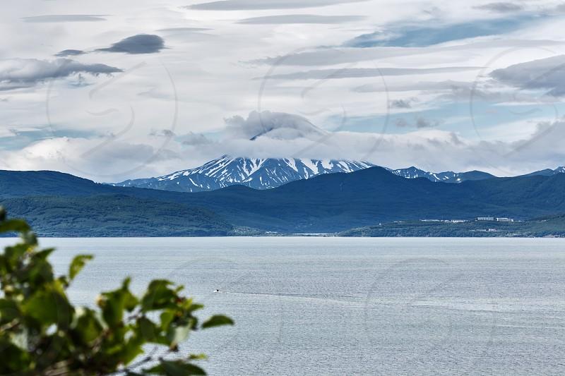 Beautiful summer Kamchatka landscape: view from city Petropavlovsk-Kamchatsky on Avachinskaya Bay (Avacha Bay) and cone Vilyuchinsky Volcano. Russia Far East Kamchatka Peninsula. photo