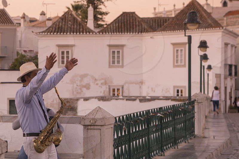 streetmusic on the Bridge Ponte Romana in the old town of Tavira at the east Algarve in the south of Portugal in Europe. photo