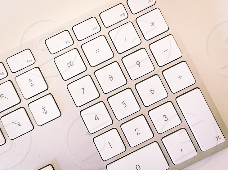 close up photo of an apple magic keyboard with number keys photo