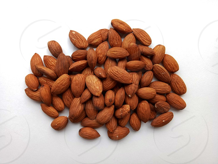 Almonds in bunches natural and healthy food ingredient photo