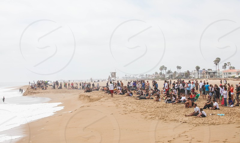 A crowd gathers at 'The Wedge' in Newport Beach CA on a day with an extremely high swell photo