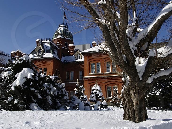 former Hokkaido Government Office in Sapporo Japan during snow winter season photo