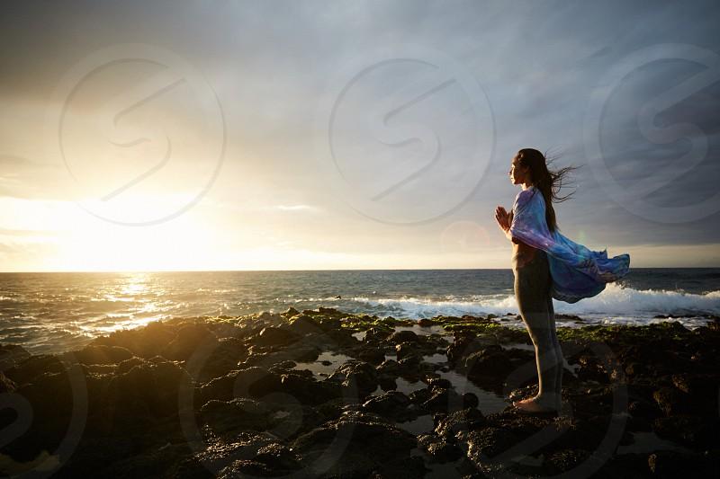 Maki sunrise yoga and meditation at Sandy Beach Park in Hawaii. photo
