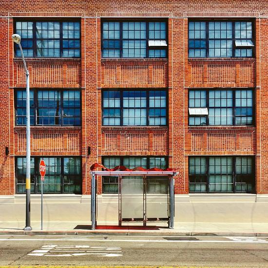 Urban street scene bus shelter brick building  photo