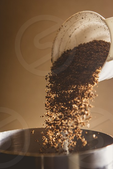 Pouring coffee grounds.  photo