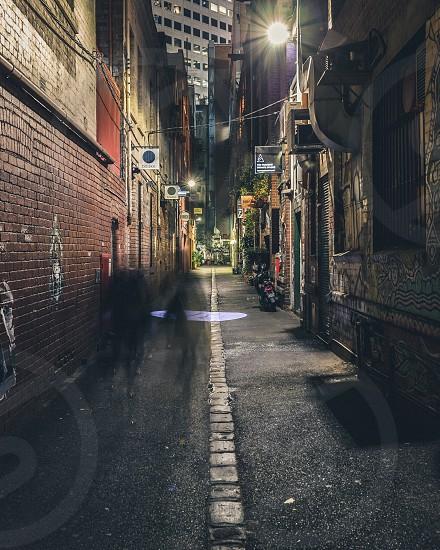 Melbourne lanes laneways winter long exposure movement and blur night night photography coffee culture winter nights hidden cafes graffiti cobble stoned lane Victoria Australia photo