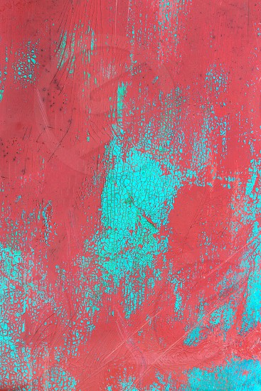 abstract cracked texture in pale red and turquoise photo