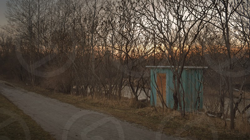 a green shack along a city park path photo