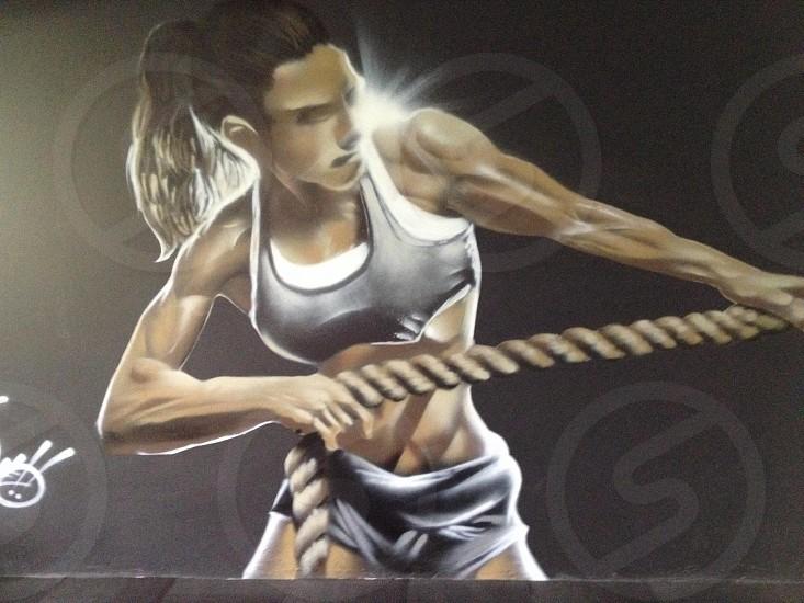 female pulling rope painting photo