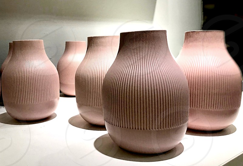 Collection of tan pottery vases photo