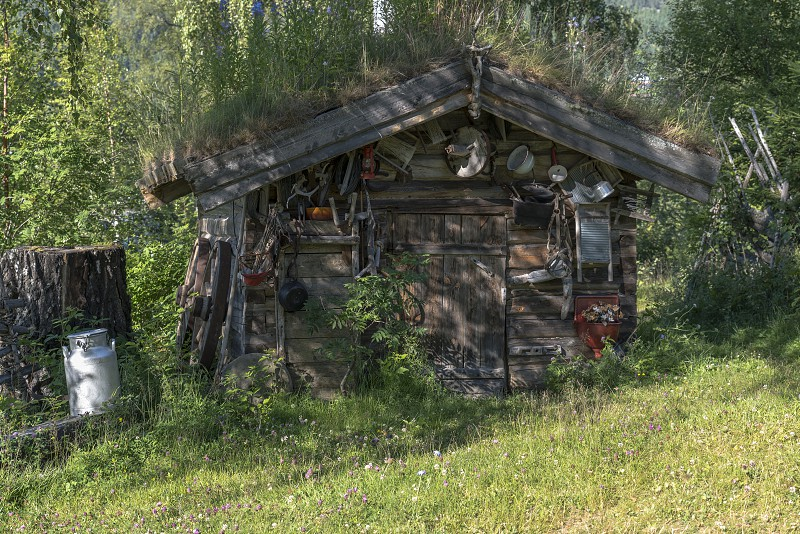 old wooden house with a lot of zink equipment like potspans and other photo