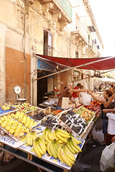 the fruit and fegetable market in the old Town of Siracusa in Sicily in south Italy in Europe. photo