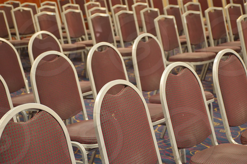 Group of brown chairs in rows photo