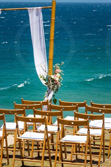 Beach wedding. Bride and groom weddings outdoor wedding chairs seating photo
