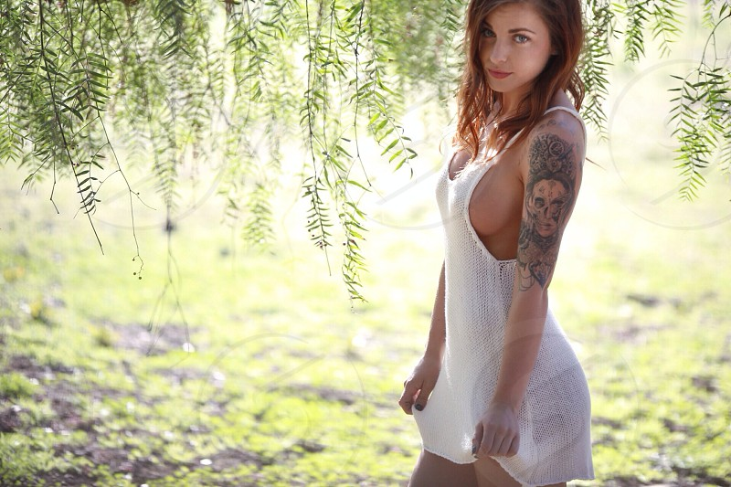 woman wearing a white tank dress photo
