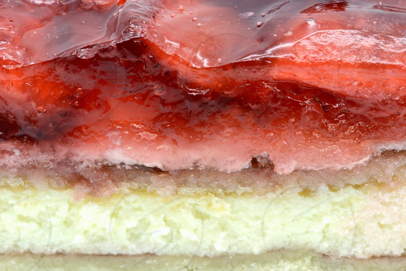 full frame of Strawberry cake piece with jelly and quark. photo