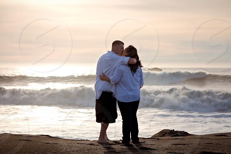 Couple on the beach date night love beach waves  photo