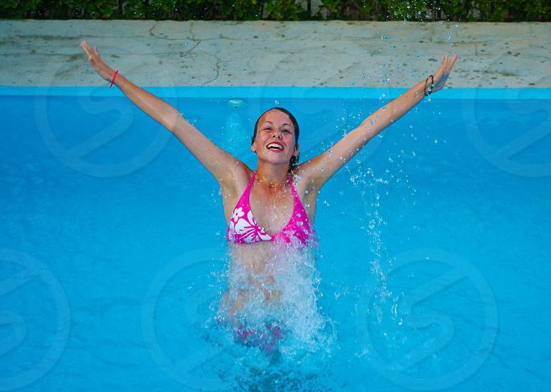 woman wearing a pink halter bikini top in a pool photo