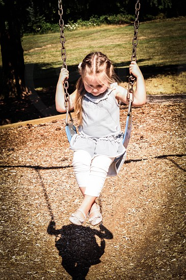 girl sitting on swing photo