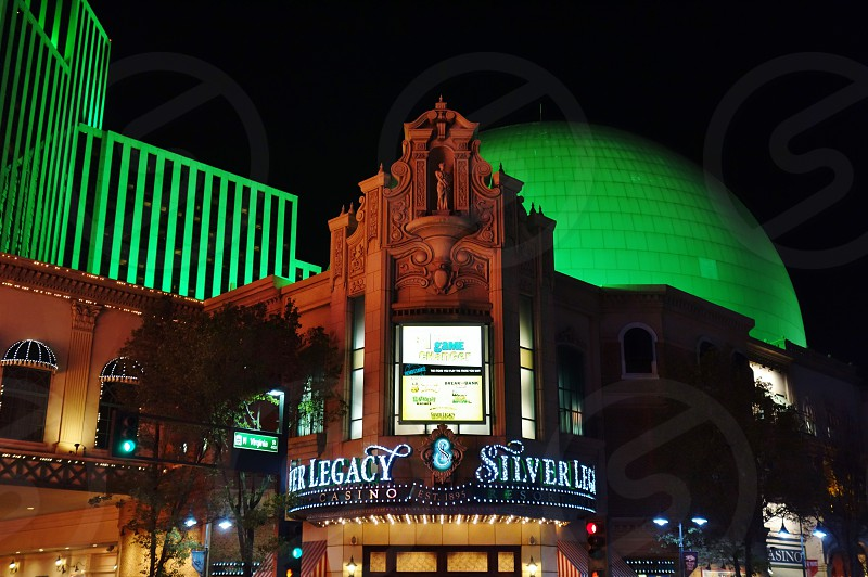Night view of the Silver Legacy hotel and casino in Reno Nevada photo