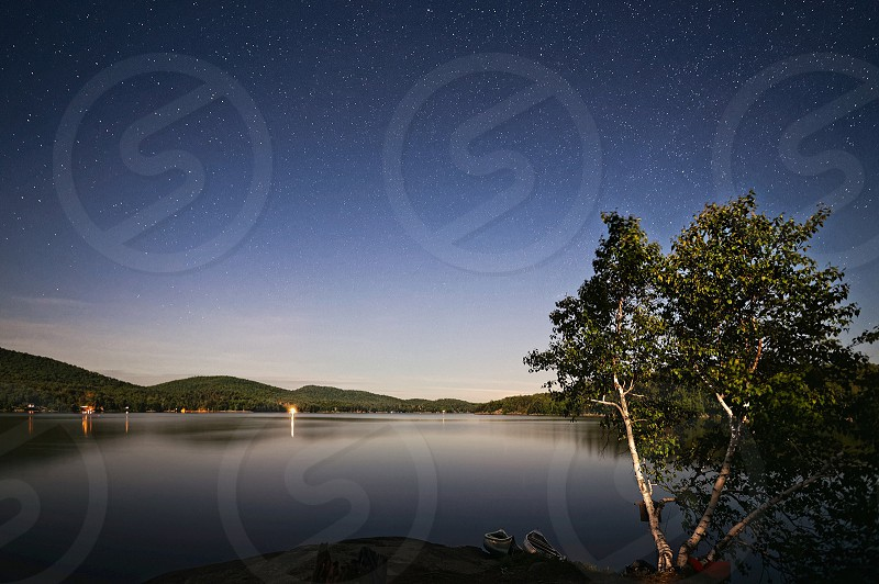 Camping lakeside lake hiking night stars landscape wilderness adventure nature trees water wide angle backpacking island photo