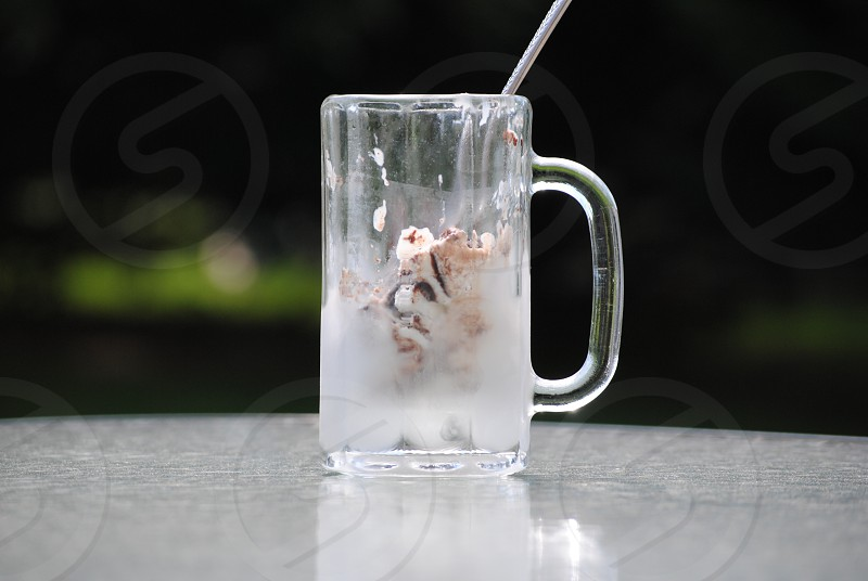 ice cream frosted mug outdoors sunny photo