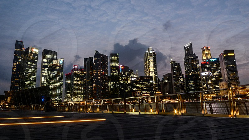 Downtown district in Singapore by sunset photo