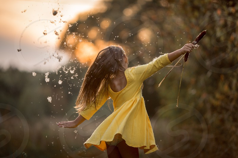Little girl in yellow dress outdoor portrait at sunset  photo