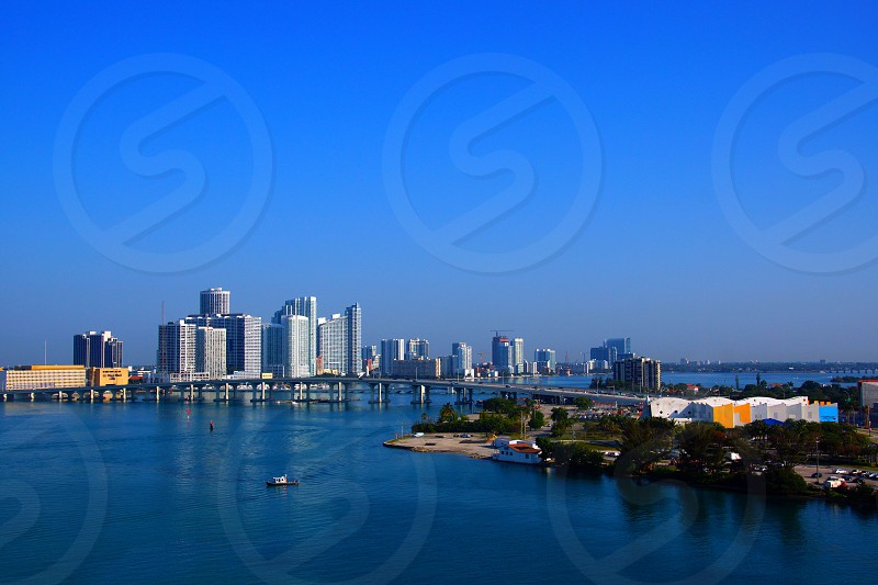 white high rise building across the sea photo