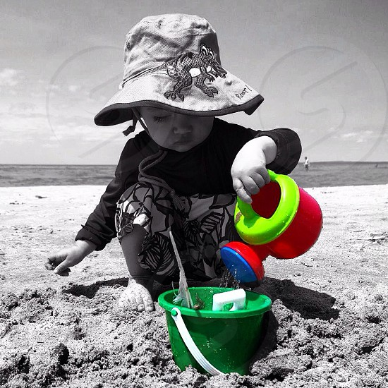 girl playing on the sand photo