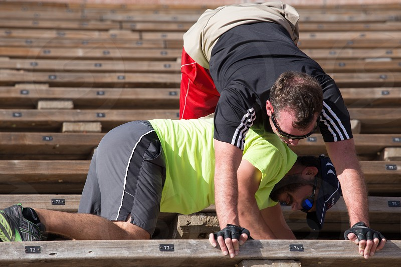 Two men exercising on steps of outdoor at Red Rocks amphitheatre Denver Colorado     photo