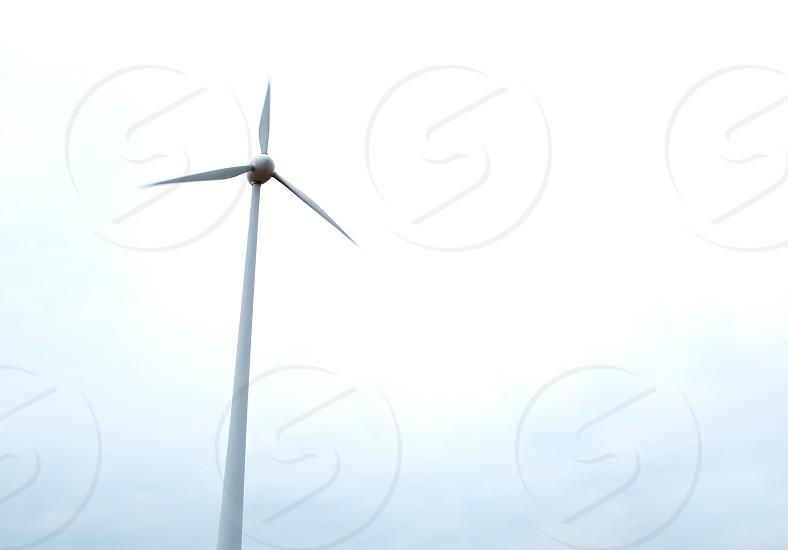 Wind turbine over the sky background. photo