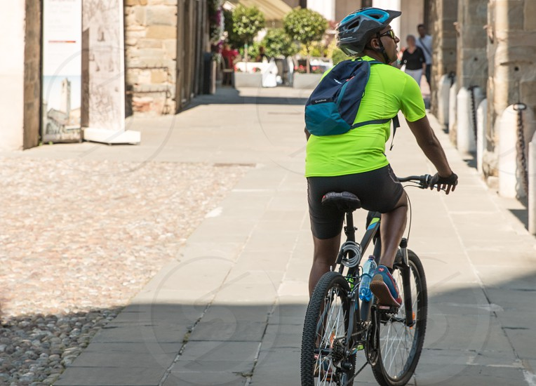 Cyclist With His Bicycle In The City photo