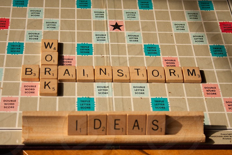scrabble tiles as ideas word on rack and brainstorm and work woods on board photo